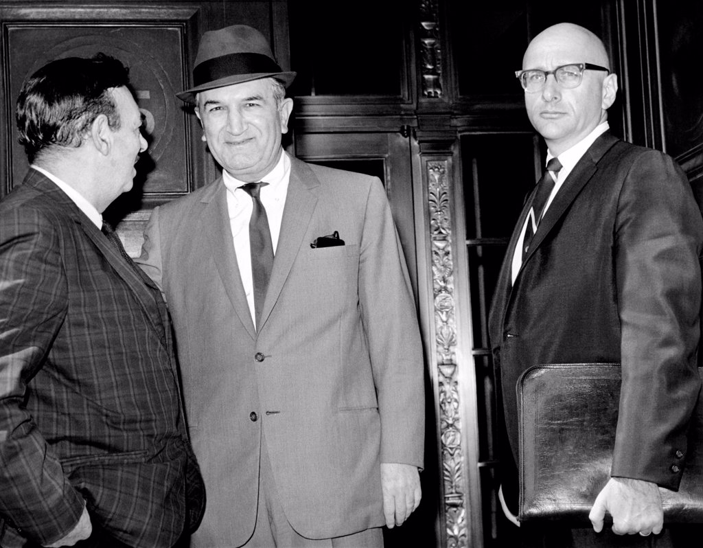Joseph (Joe Bananas) Bonanno (center) talks to UPI reporter Robert Evans on steps of Federal Courthouse. Bonanno is accompanied by his attorney, Albert J. Krieger. May 17, 1966. : Stock Photo