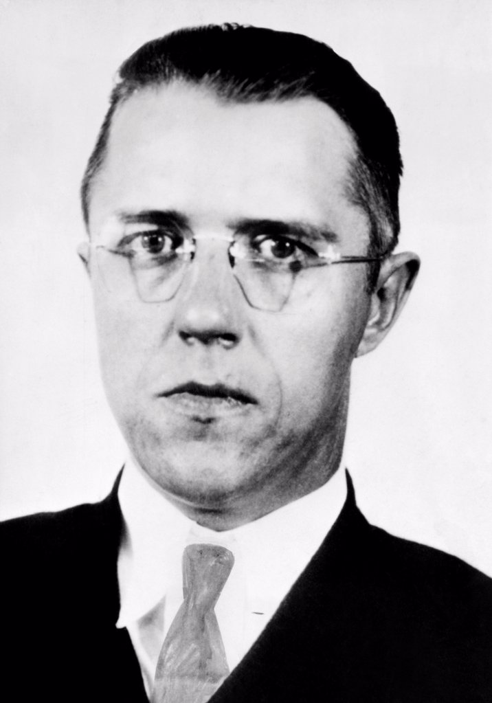 Stock Photo: 4048-9697 Alvin Karpis, was captured by J. Edgar Hoover and his men in New Orleans. His plastic surgery to change his appearance failed him. The mug shot was made in St, Paul, Minn. Ca. 1936.
