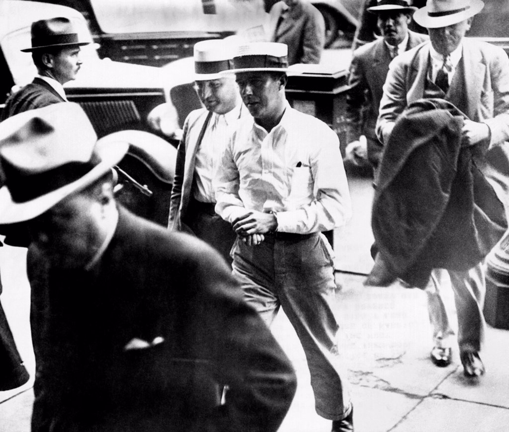 Stock Photo: 4048-9699 Alvin Karpis, 'Public Enemy No. 1', walks behind his captor, J. Edgar Hoover, director of the FBI, (at left) into Federal Court in St. Paul, Minn. May 03, 1936.