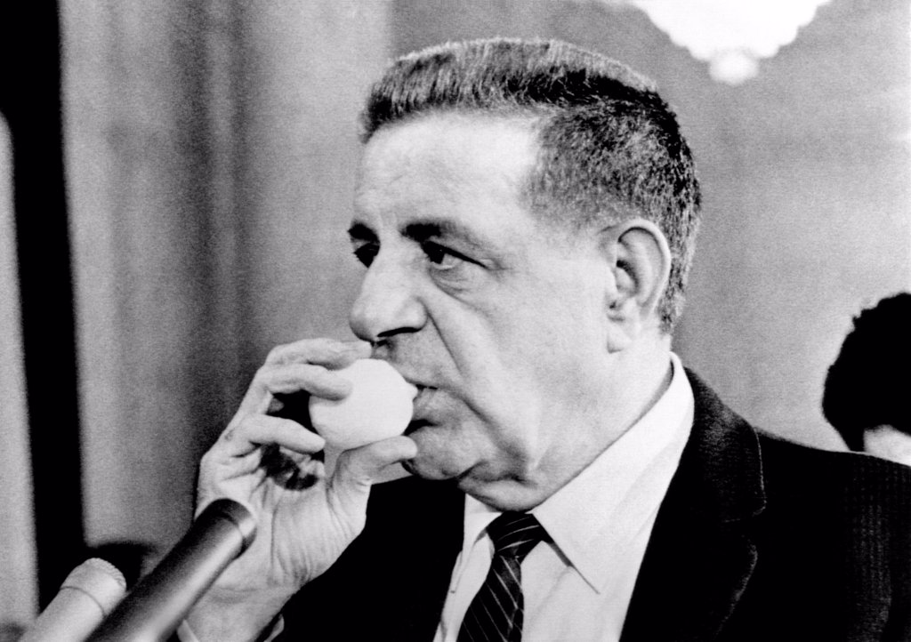 Joseph Valachi sucking a lemon juice container during Senate Investigations Subcommittee. The juice eased his hoarseness from continuous testimony. Oct. 2, 1963. : Stock Photo