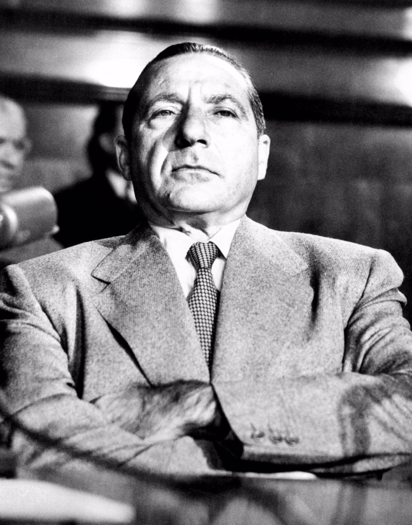 Stock Photo: 4048-9729 Mob boss, Frank Costello in the witness chair. Under the threat of arrest, after he walked out on the Senate Crime Investigating Committee on the previous day, he again refused to testify on the grounds that he was too ill. March 16, 1951