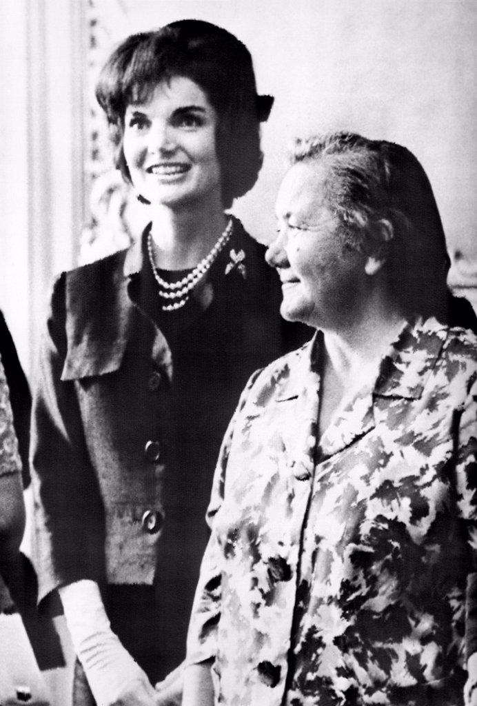 Jacqueline Kennedy and Nina Khrushchev (right) during a luncheon given in their honor in Vienna, Austria. Their husbands, President John Kennedy and Soviet Premier Nikita Khrushchev were having a contentious summit meeting at the Soviet Embassy. June 4, 1961. : Stock Photo