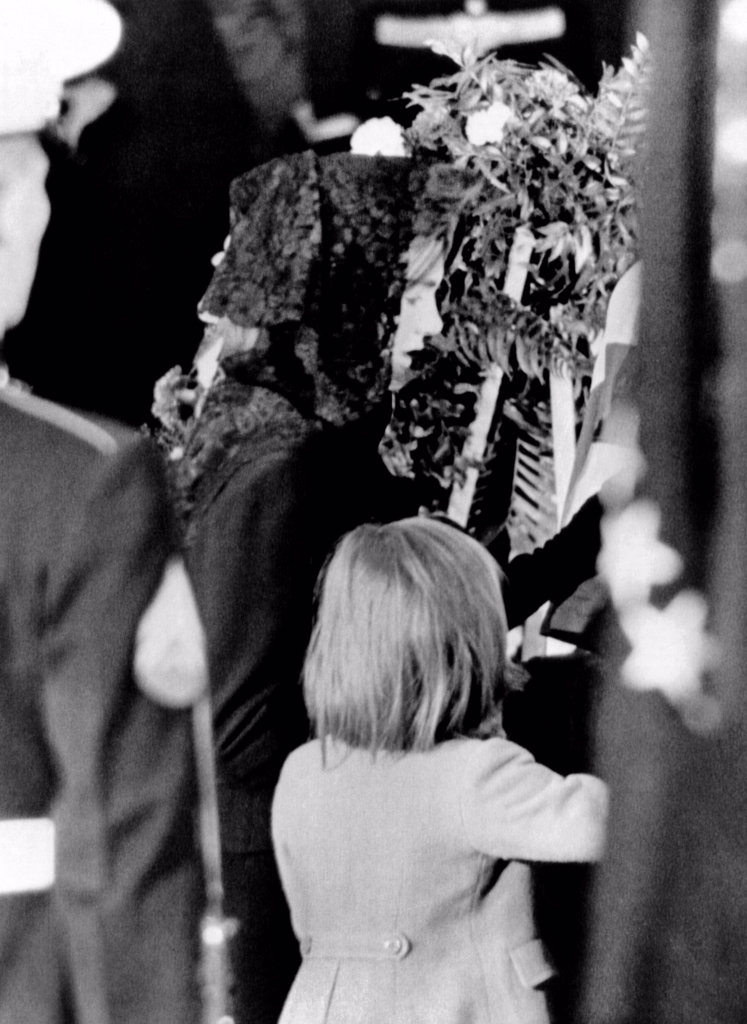 President John Kennedy's lying in State ceremonies. Jacqueline and Caroline Kennedy at the late President's coffin in the Capitol Rotunda. Nov. 24, 1963. : Stock Photo