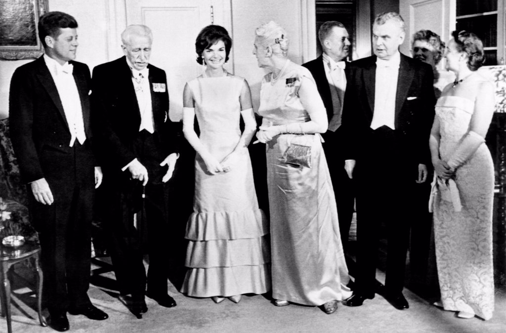President John Kennedy visiting Canada. The Kennedy's gave his Canadian hosts a dinner at the US Embassy. (L-R) President Kennedy, Gov. Gen. George Vanier, Jacqueline Kennedy, Mrs. George Vanier, Ambassador Livingston Merchant, Prime Minister John Diefenbaker, Mrs. Merchant, and Mrs. Diefenbaker. May 17, 1963. : Stock Photo
