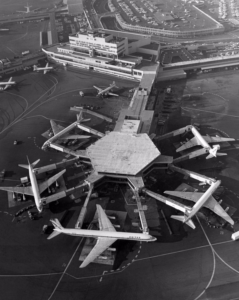 A Super DC-8 airplane (bottom) sits at the United Airlines terminal at the San Francisco International Airport, 1967 : Stock Photo