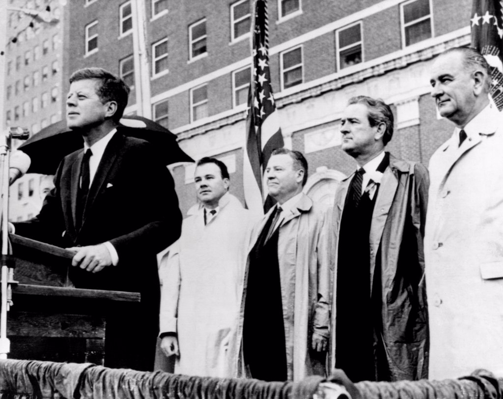 Morning of the day of JKF's assassination. President Kenney speaks to a crowd in front of the Texas Hotel in Fort Worth during a light rain. Behind him are (L-R): Senator Ralph Yarborough; Texas Governor John Connally, and Vice President Lyndon Johnson. Nov. 22, 1963 : Stock Photo