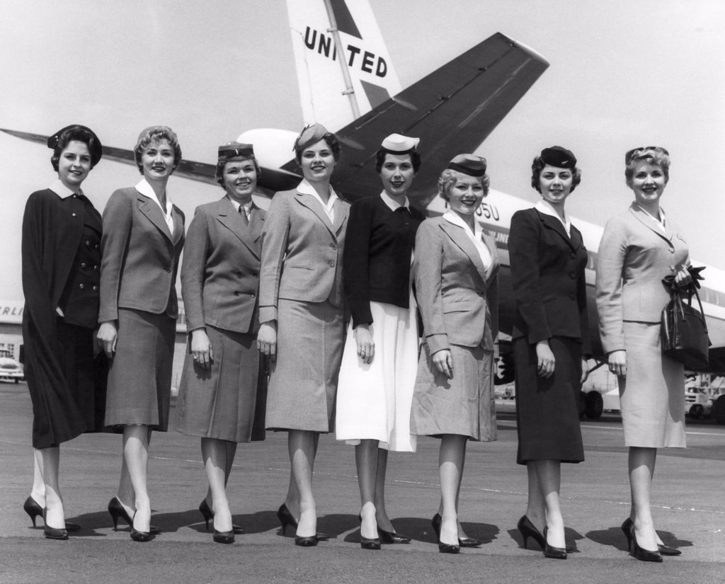 Stock Photo: 4048-994 United Airline's stewardesses model thirty years of uniforms. Joyce Strang, 1930; Joan Kennedy, 1936; Marian Kopie, 1933; Sharon Ditter, 1937; Colleen Hallett, 1939; Sheri Moore, 1941; Lois Ambruson, 1951; Dorothy Scafard, 1960. 1960