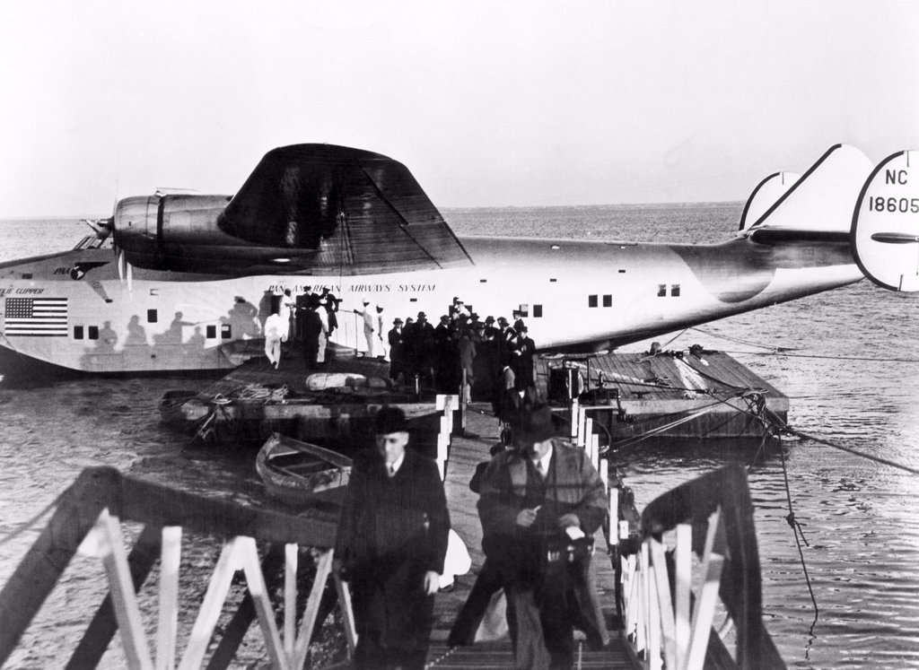 Stock Photo: 4048-996 The first passengers to cross the Atlantic leave Pan American's Dixie Clipper airplane in Lisbon, Portugal. The plane took off from Port Washington, New York, 1939