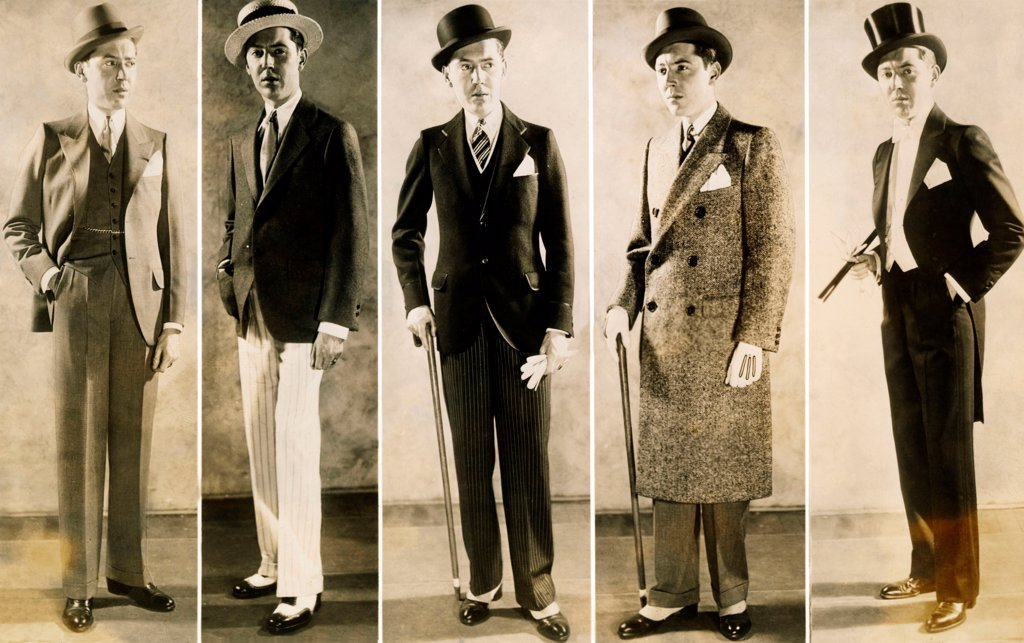 Stock Photo: 4048-9964 The well dressed man's wardrobe in 1929. L-R: Business suit, Sporting wear, Afternoon dress suit, Tweed overcoat, and a tuxedo for formal evenings.