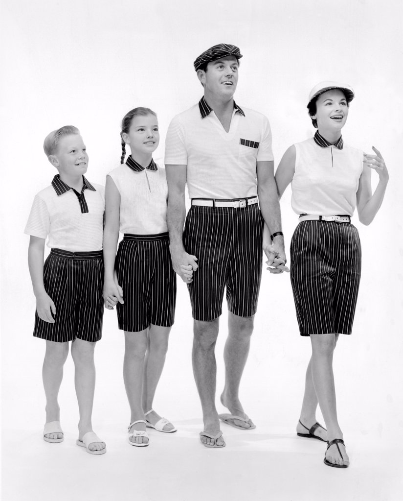 Jantzen sportswear presented the summer wear as 'Regimental Stripes' for the whole family. 1957. : Stock Photo