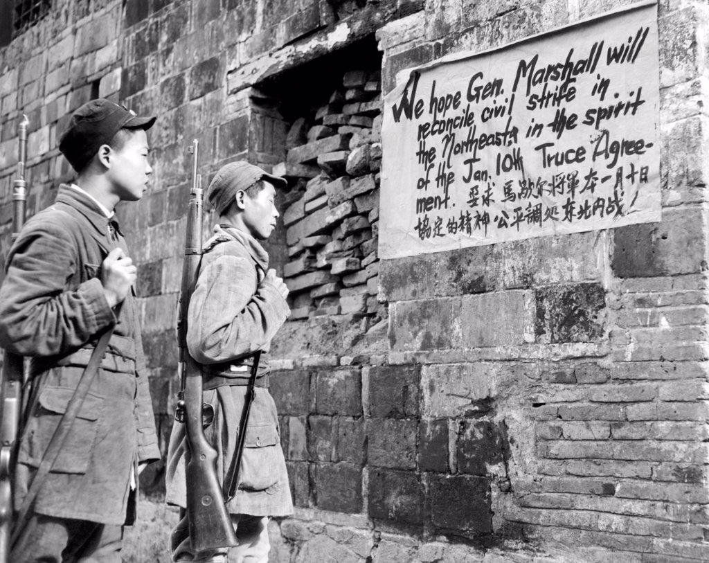 Stock Photo: 4048-9998 Communist Soldiers of the New Fourth Army reading a sign painted in English and Chinese, urging Sino-American friendship and calling for increased hope that Gen. George C. Marshall (US Secretary of State) will end the civil war in north China. June 7, 1946.