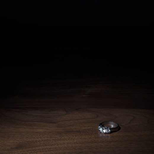 Stock Photo: 4049R-136 Diamond ring on a table