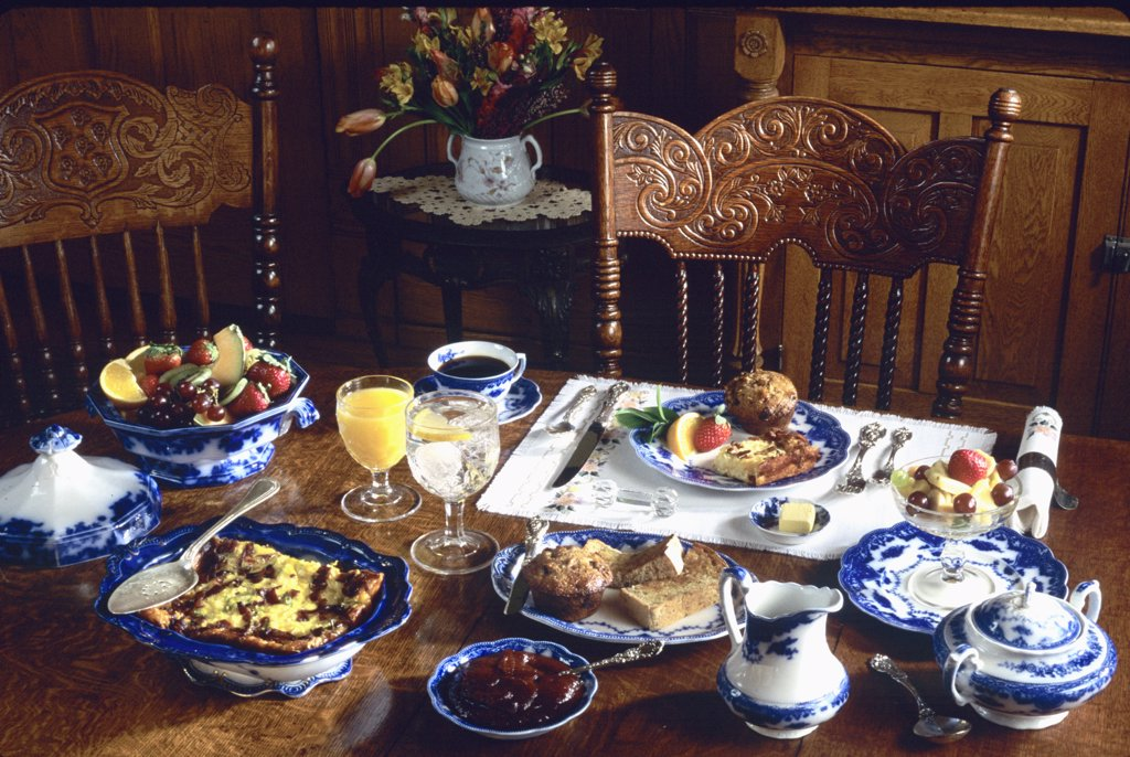 Stock Photo: 4053-10014 PLACE SETTINGS: Antique flow blue china, breakfast, oak pressed back chairs,