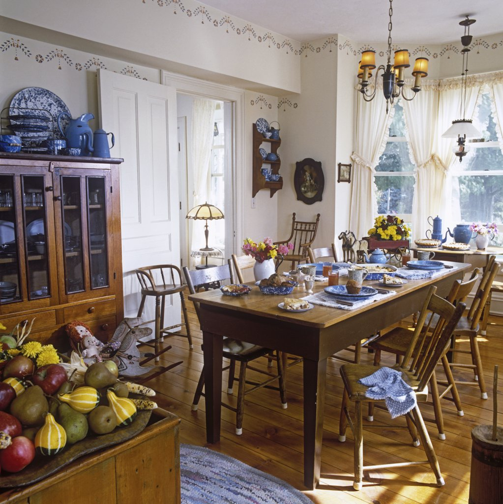 EATING AREAS: Breakfast room, Victorian country style, wood floors, table set for apple pie dessert, white walls, china cabinet, antiques, windows with white curtains. : Stock Photo