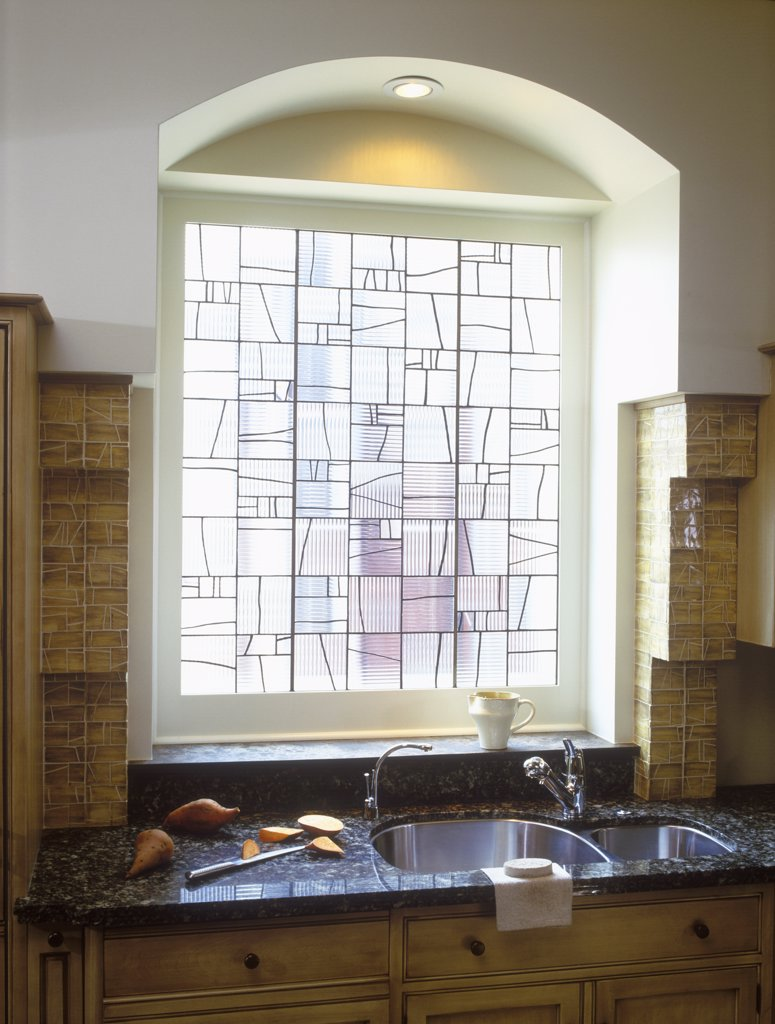 Stock Photo: 4053-10459 KITCHEN: Leaded glass window. Sink, tile corbels. Granite.