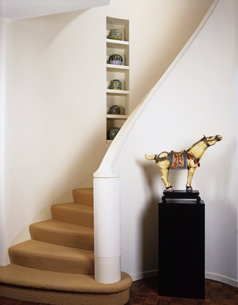 Stock Photo: 4053-10507 hall and stairway in city home, Chinese ivory horse statue