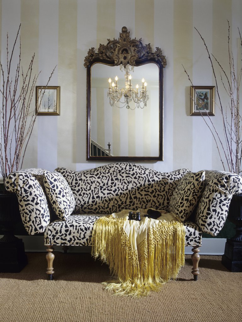 Stock Photo: 4053-10625 entry hall: Sofa with leopard print, gilded mirror, painted stripe wall, sisal wall to wall carpet