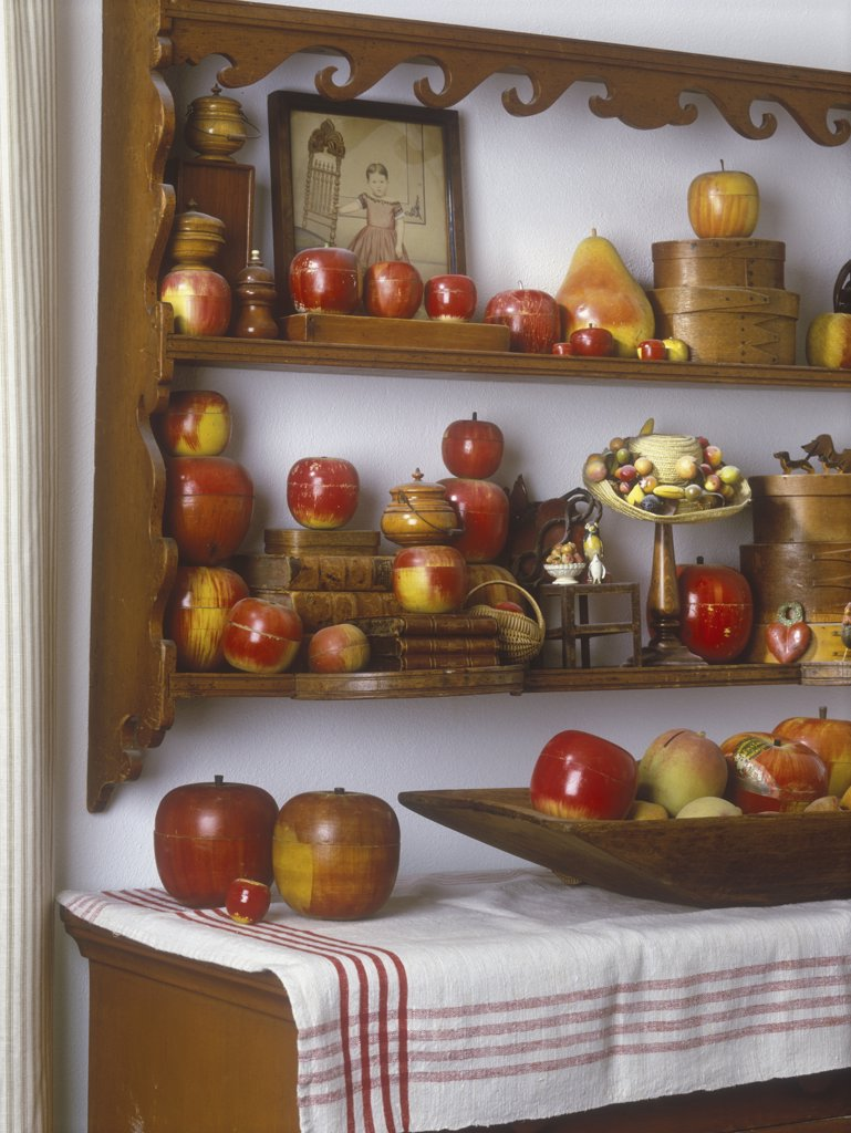 COLLECTION DISPLAY - Originally made as play things vintage wooden apples made in Germany and Japan in 1940's-1950's grouped on shelves and table. : Stock Photo
