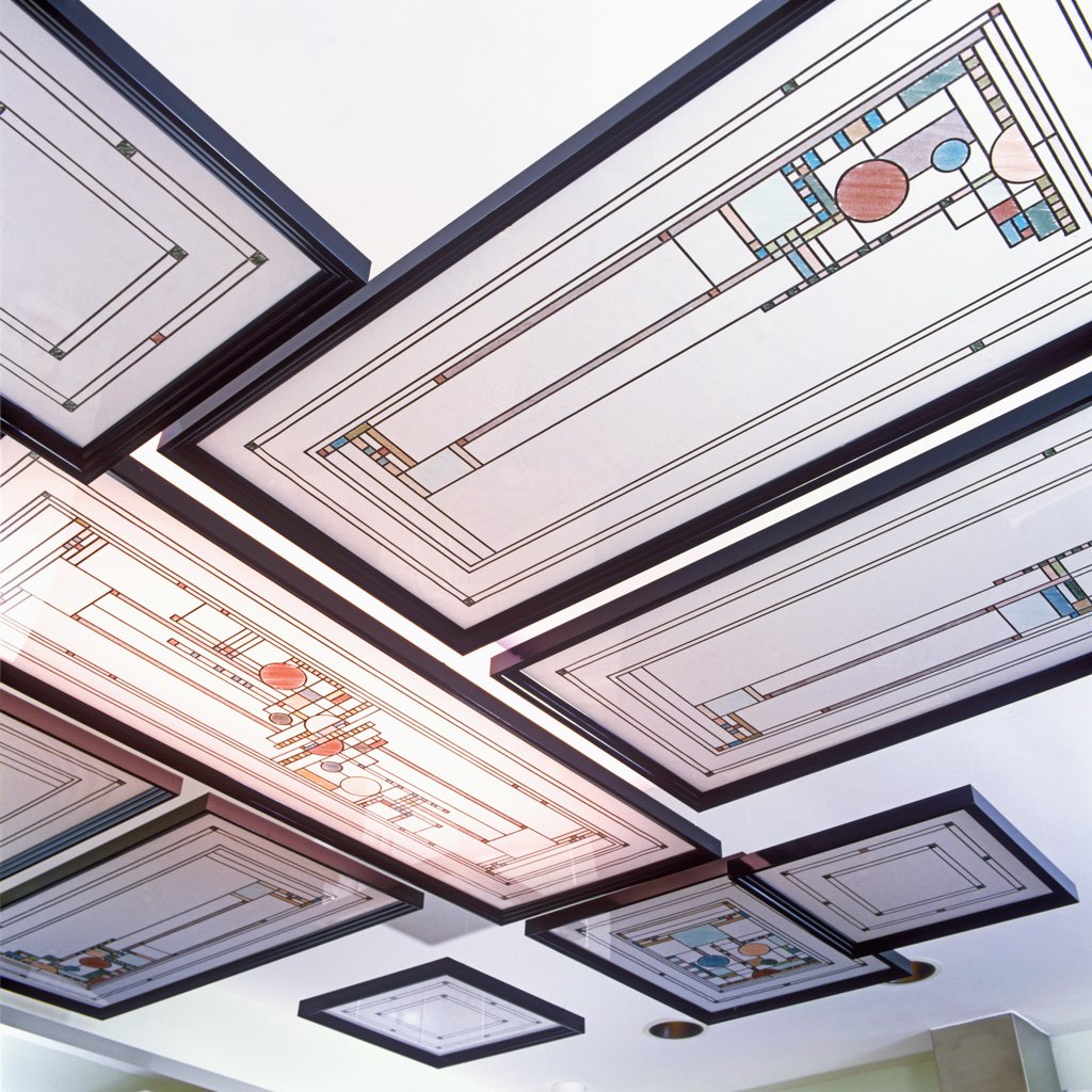 STAINED GLASS WINDOWS - Detail of creative use of stained glass windows in a kitchen. Windows are suspended from ceiling. Windows are Frank Lloyd Wright design. : Stock Photo