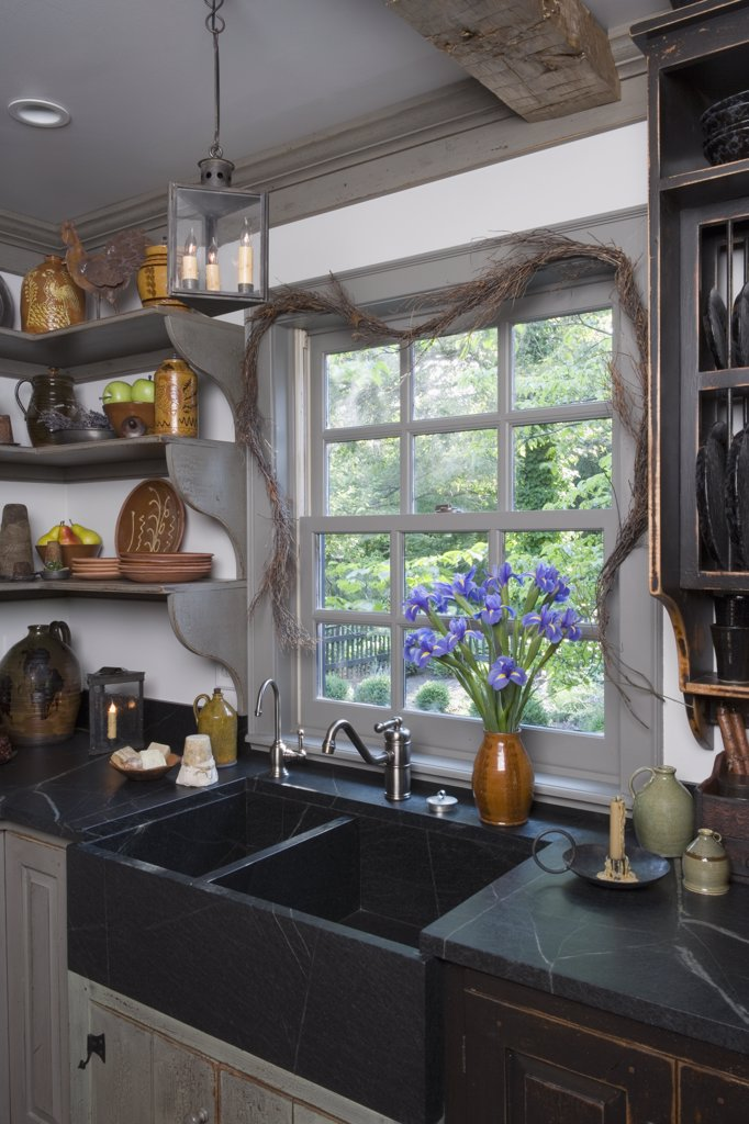 KITCHENS: sink area , soapstone farmers sink and counters, period style , furniture style cabinets by David Smith : Stock Photo