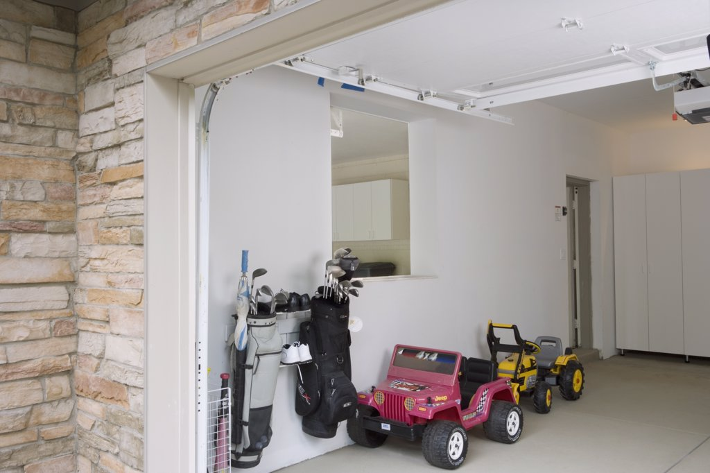 GARAGE STORAGE: clean and organized after pictures two kids toy cars, and golf clubs : Stock Photo
