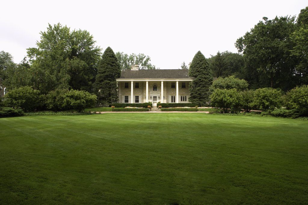 Stock Photo: 4053-12312 EXTERIORS: Lannonstone Colonial Revival, expansive lawns and manicured gardens in front of house, overall straight on view