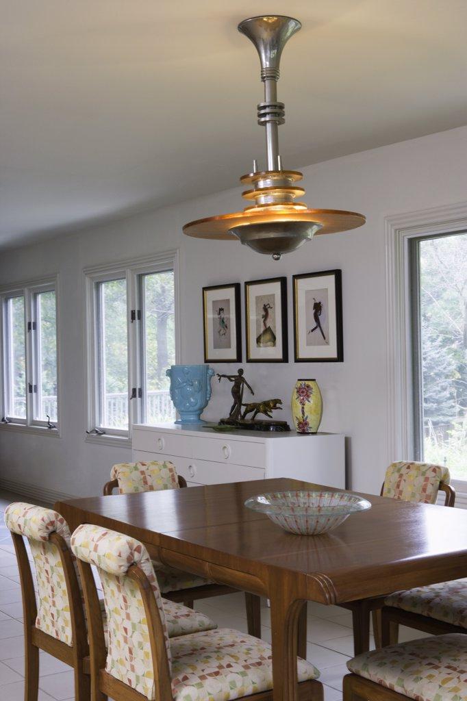 DINING ROOM ; antique French Art Deco chandelier, art vases, bronze sculpture : Stock Photo