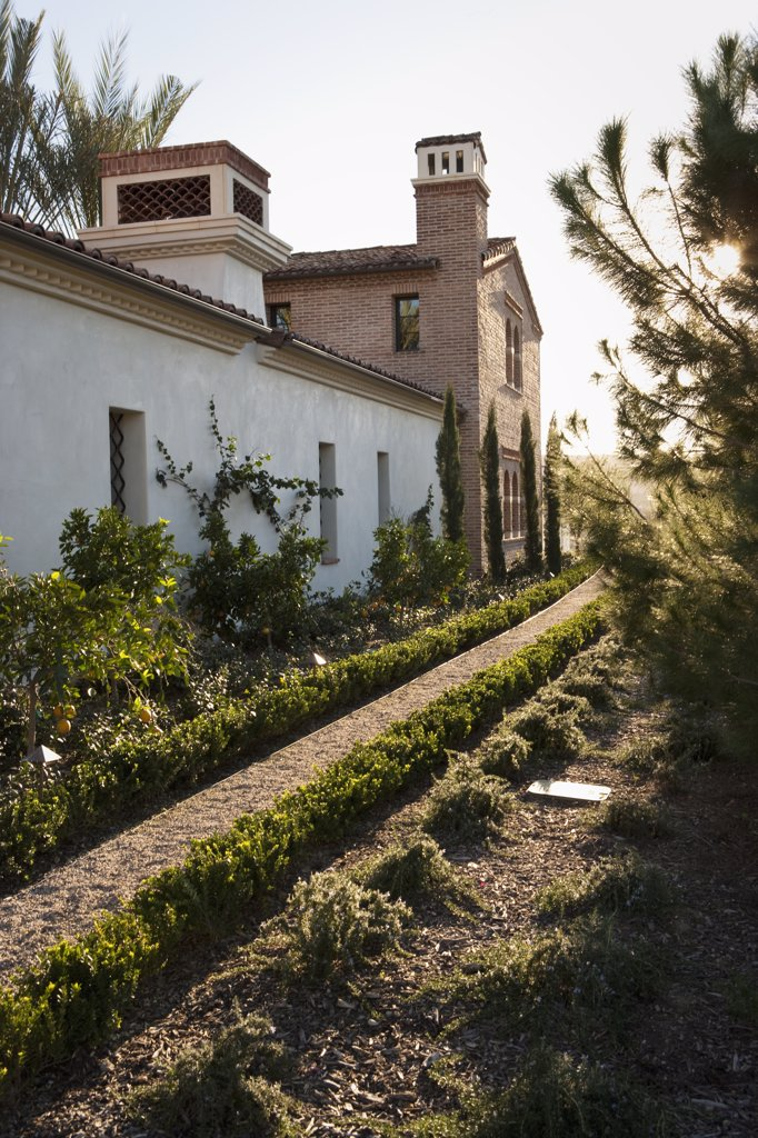 Pathway along front of andalucian style home : Stock Photo