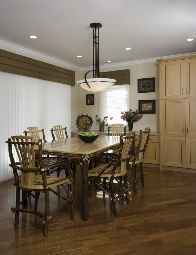 Stock Photo: 4053-12567 KITCHEN EATING AREA: bentwood twig dining table and chairs, soften a contemporary traditional  kitchen, sheer vertical blinds with taupe valance, pendant light, wood floors, built in cabinet
