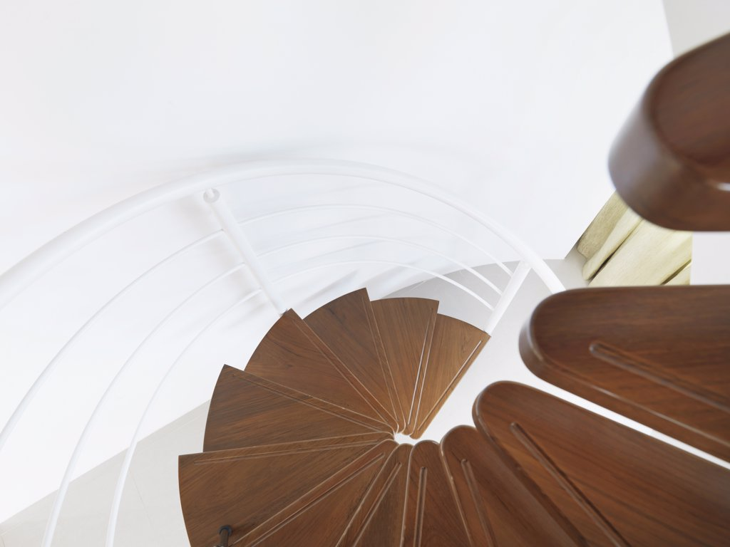 Detail of wooden spiral staircase with white railings : Stock Photo