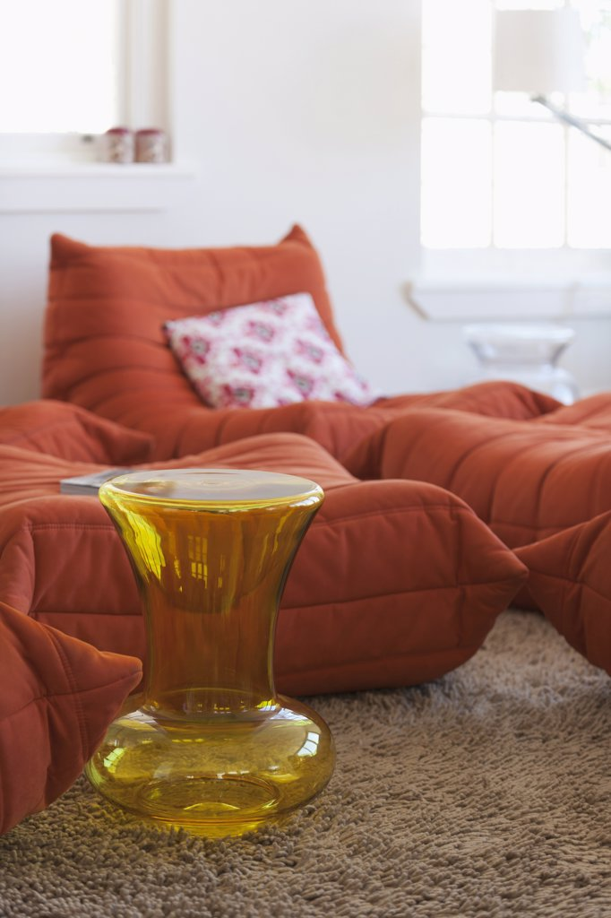 Yellow vase beside modern lounge chairs : Stock Photo