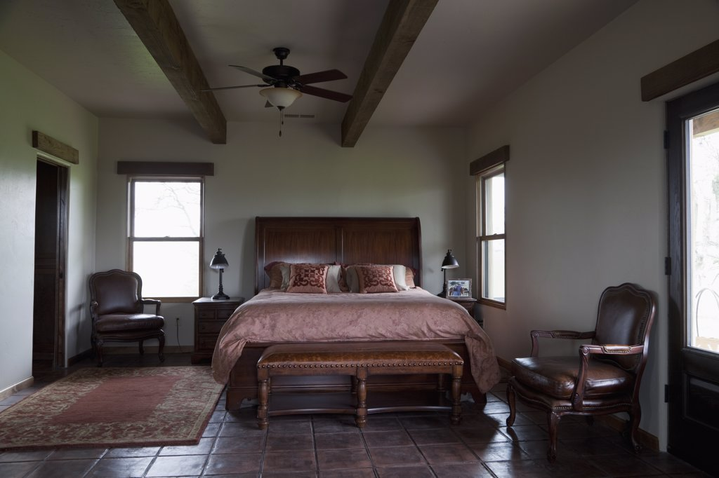 Stock Photo: 4053-13928 Leather bench at foot of master bed