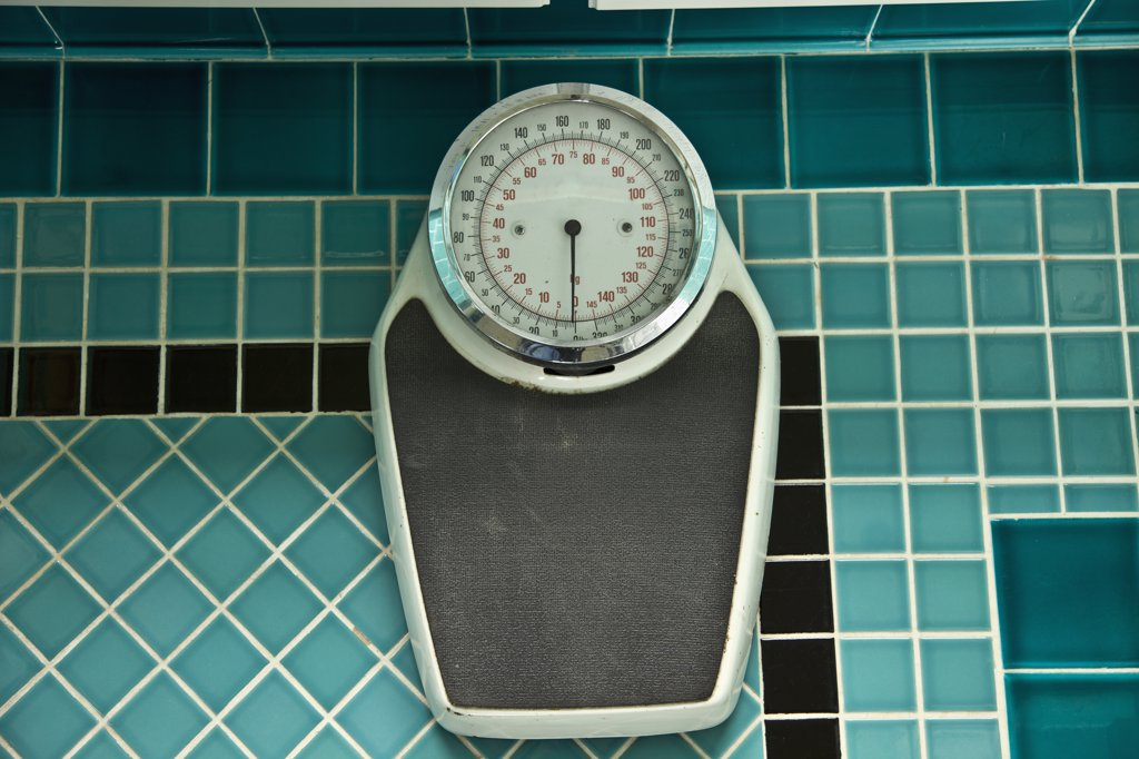 Scale on turquoise mosaic bathroom tile : Stock Photo