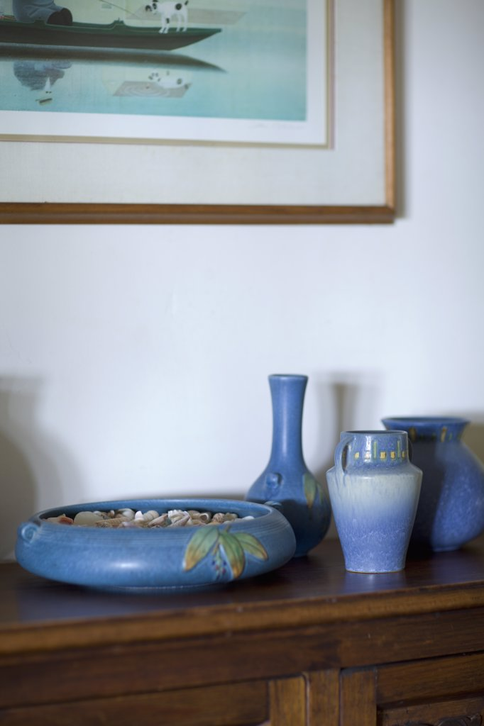 Collection of blue vases on sideboard : Stock Photo