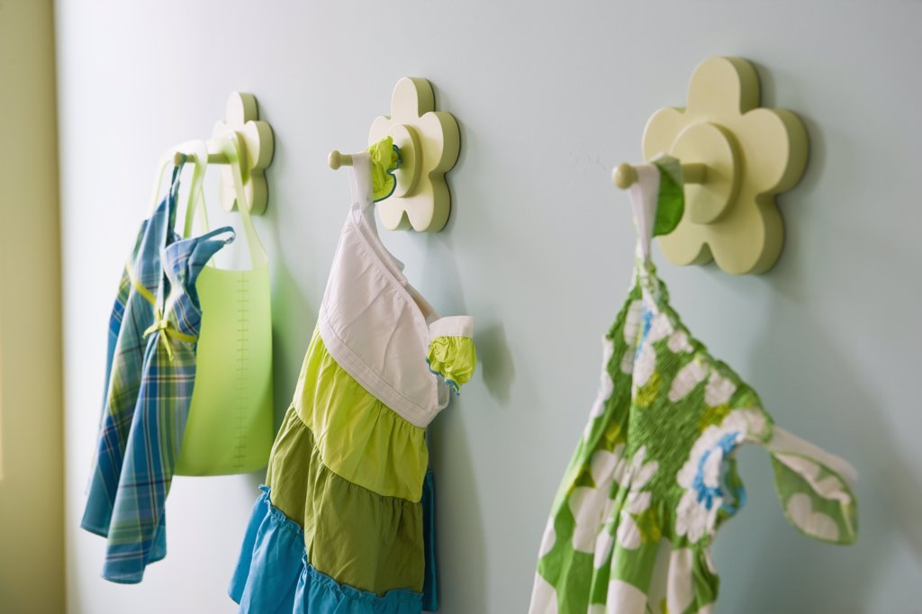Stock Photo: 4053-2478 Little girl's dresses hanging on hook