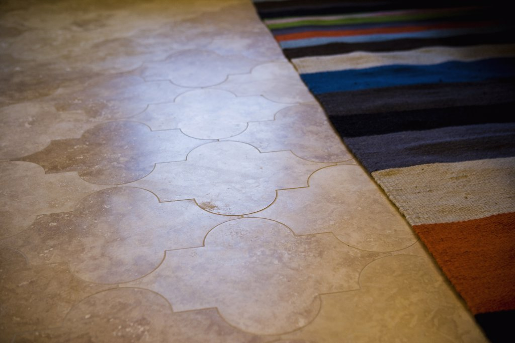Stock Photo: 4053-2634 Striped rug on tile floor