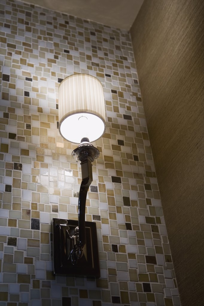 Contemporary wall sconce on mosaic tile wall : Stock Photo