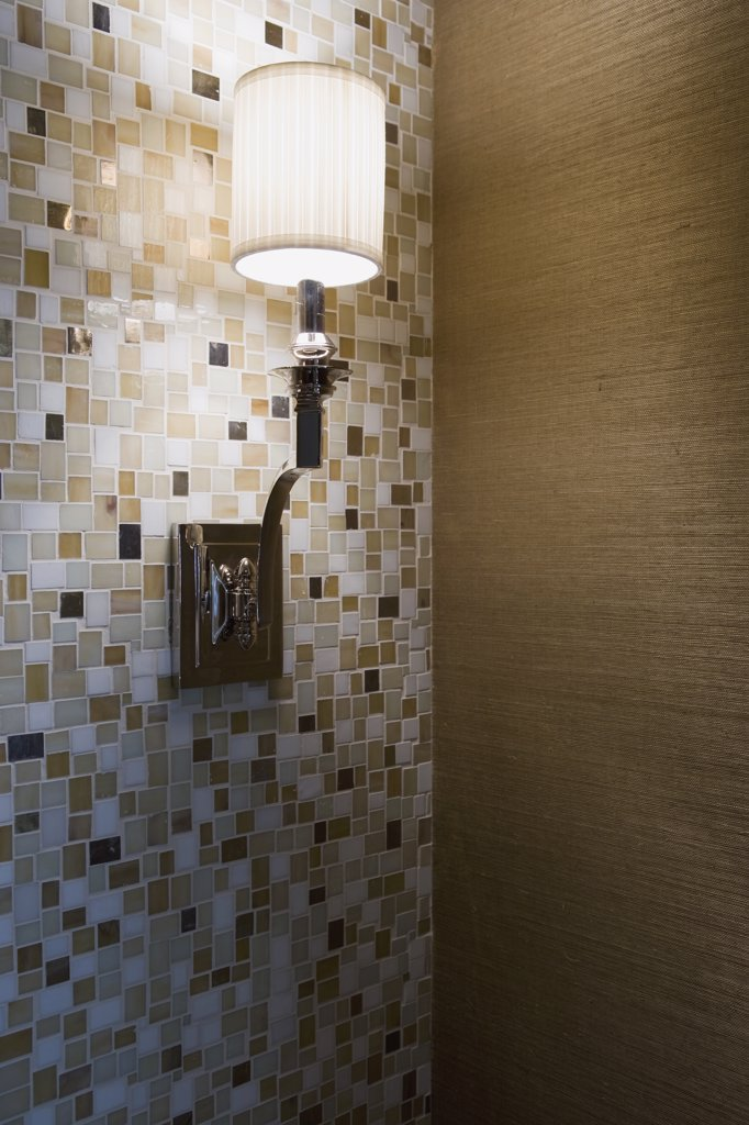 Stock Photo: 4053-2893 Contemporary wall sconce on mosaic tile wall