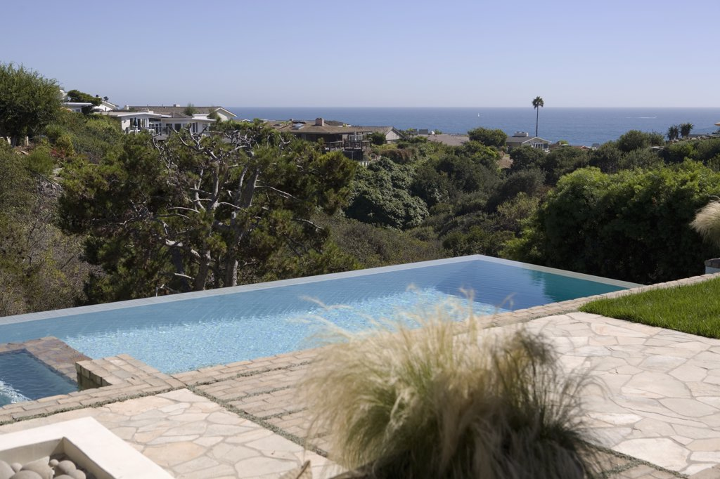 Detail backyard pool with ocean view : Stock Photo