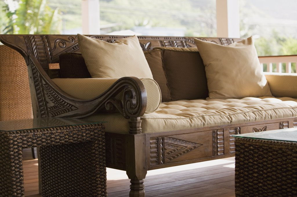 Hand Carved wooden bench with cushions : Stock Photo