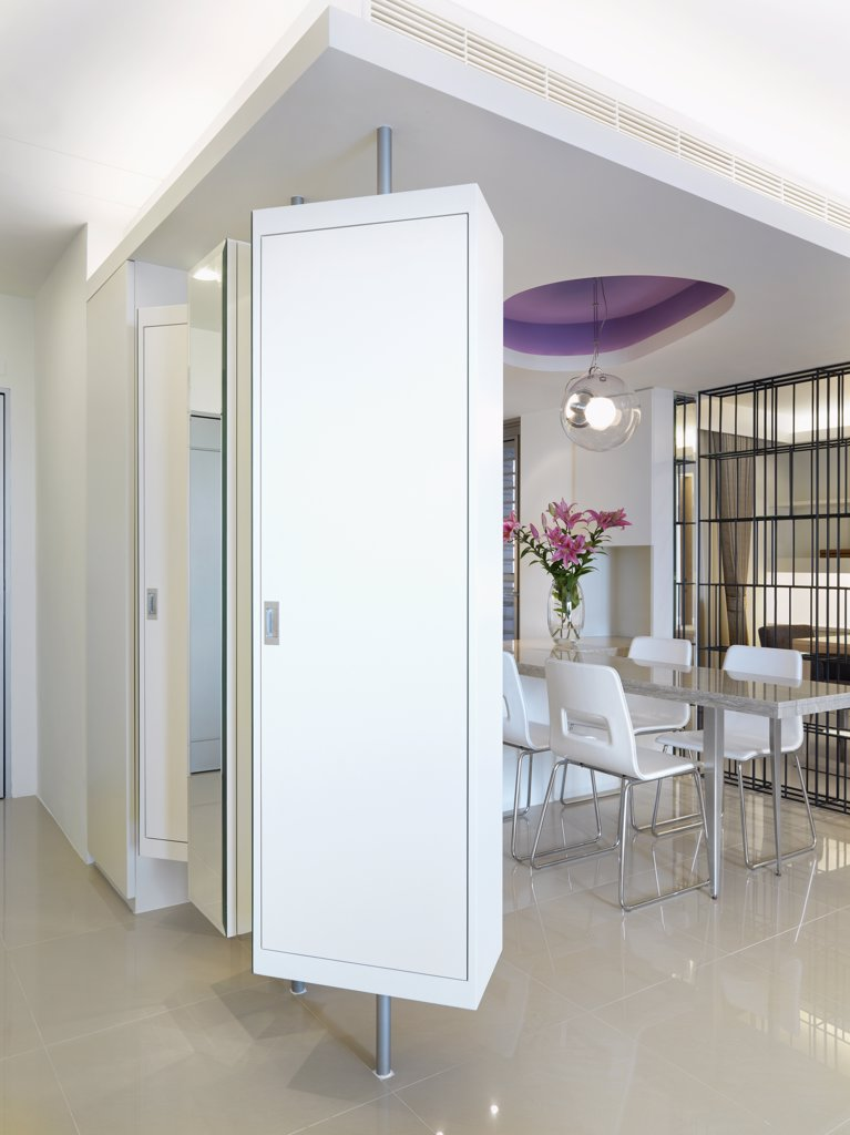 Modern interior with rotating cabinets : Stock Photo