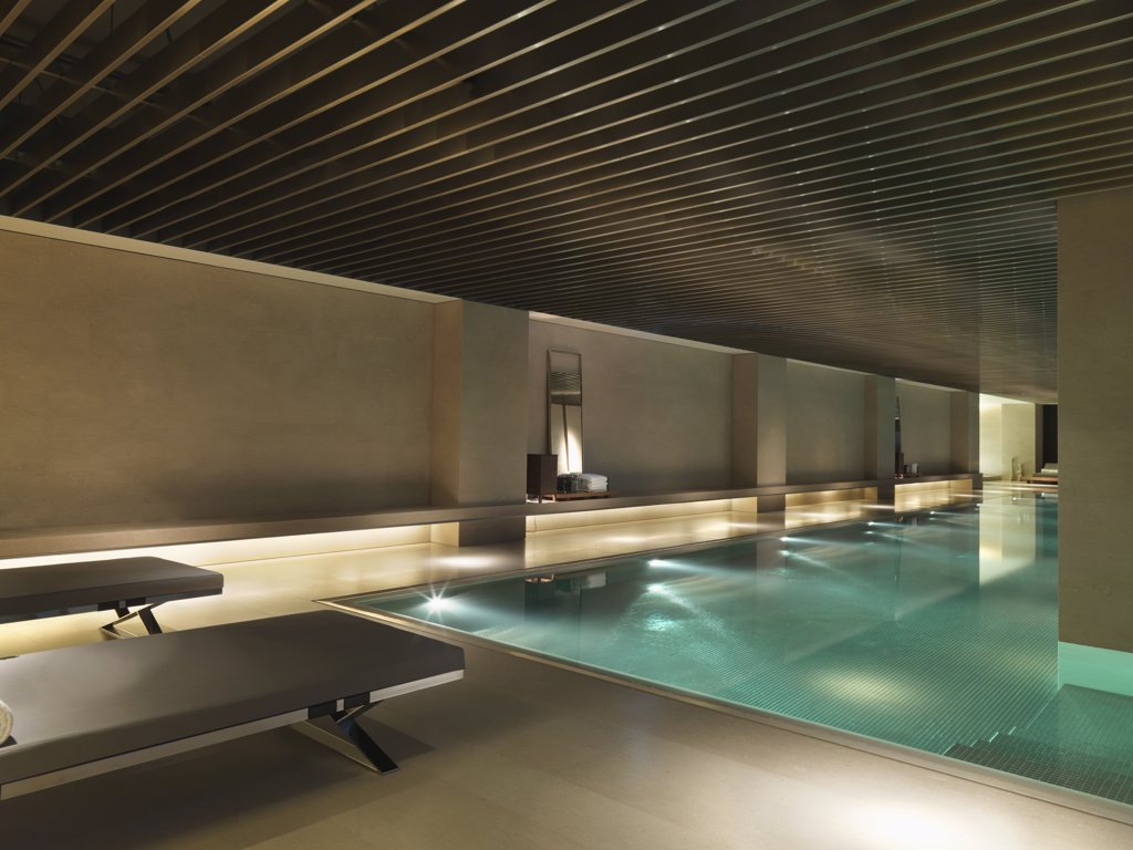 Stock Photo: 4053-6757 Long narrow indoor pool at dusk
