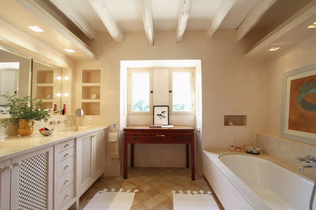 Stock Photo: 4053-8184 Sideboard, sinks and bathtub in bathroom