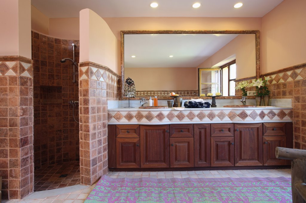 Tiled shower and countertop in Spanish style master bathroom : Stock ...