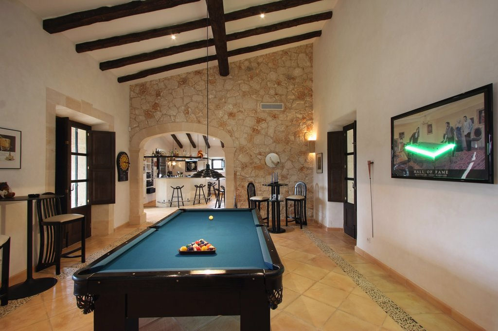 Pool table and wooden ceiling beams in Spanish style home : Stock Photo