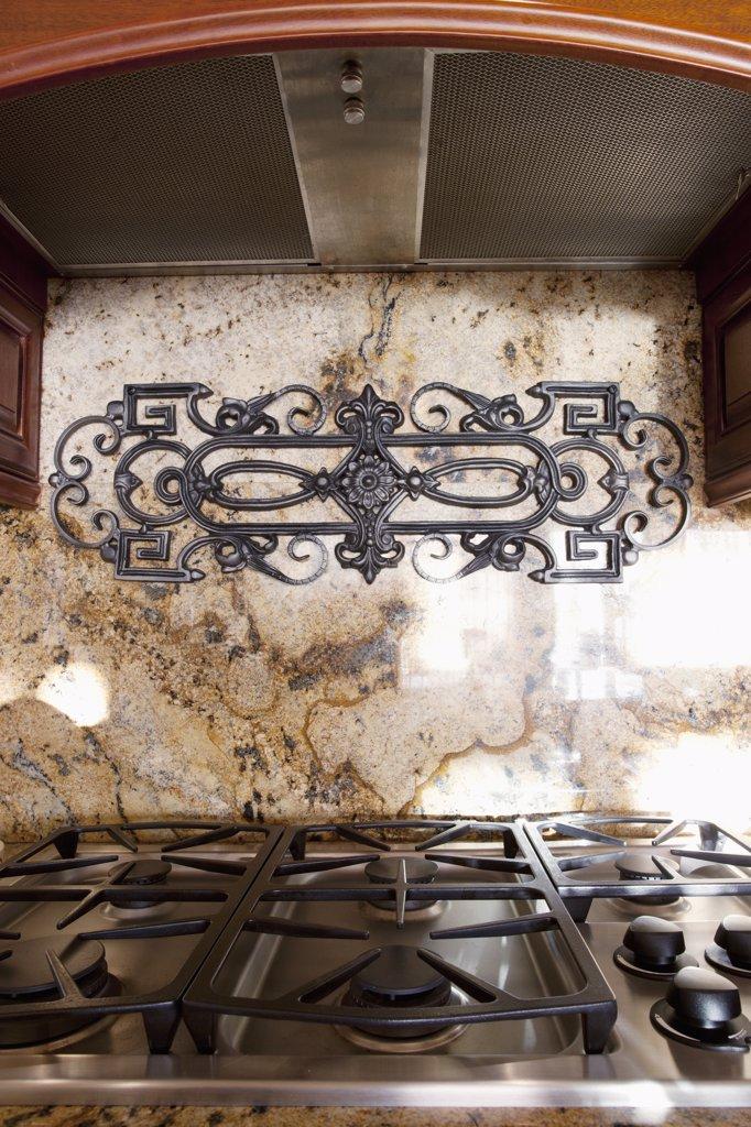 Stove top and marble backsplash : Stock Photo