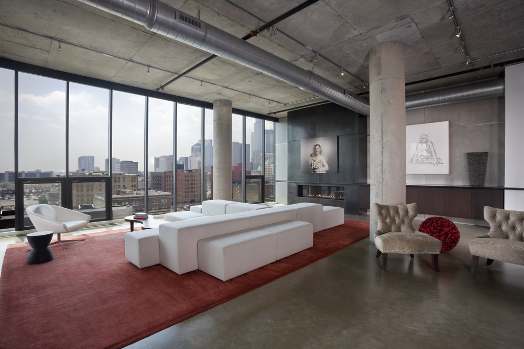 Modern loft space showing living room with view of downtown : Stock Photo