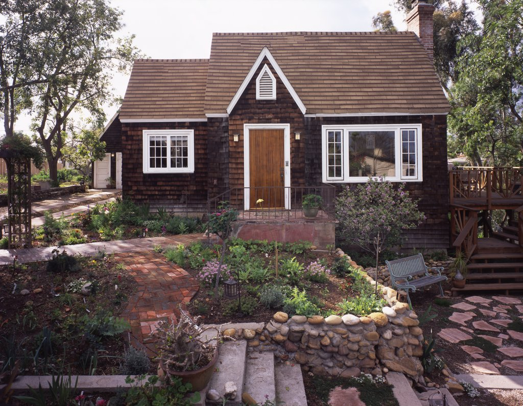 Stock Photo: 4053-9377 Front exterior wooden Cape Cod cottage and landscaping