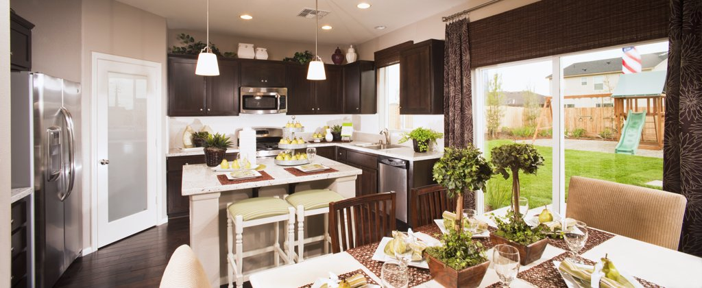 Kitchen and dining area in traditional home : Stock Photo