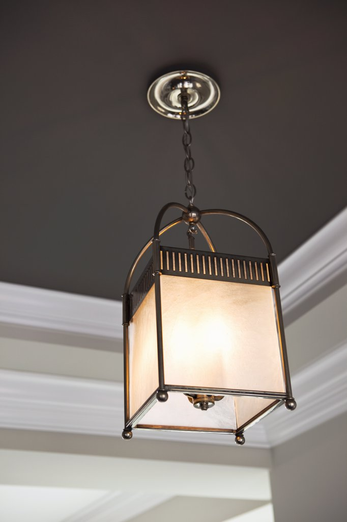 Stock Photo: 4053-9622 Hanging ceiling light and crown molding